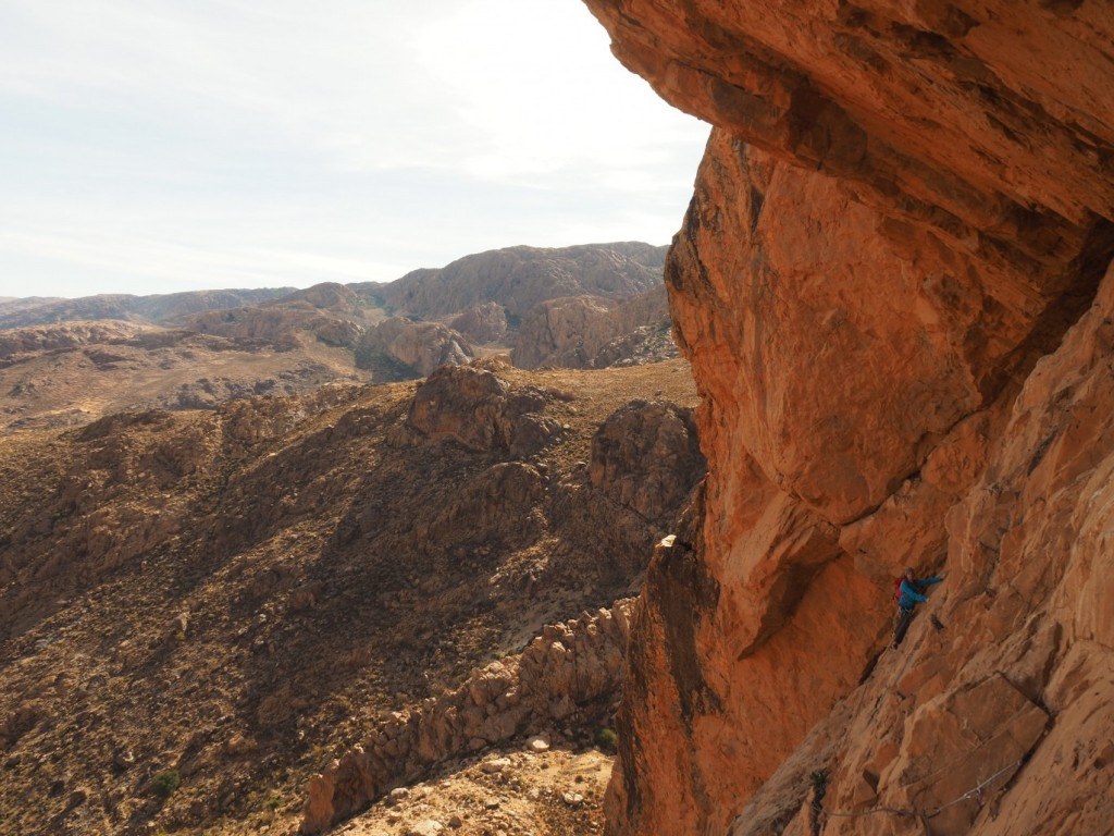 The exit traverse of the Sword of Allah. Climber: Pete Barrass